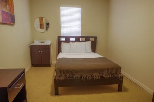 1 Queen Bed Shared Bathroom