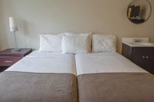 2 Twin Beds Shared Bathroom