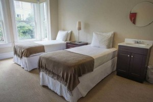 2 Twin Beds Shared Bathroom